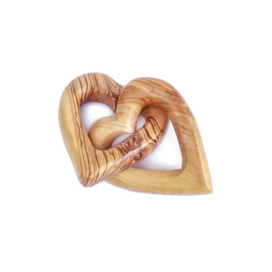 Two olive wood love hearts intertwined