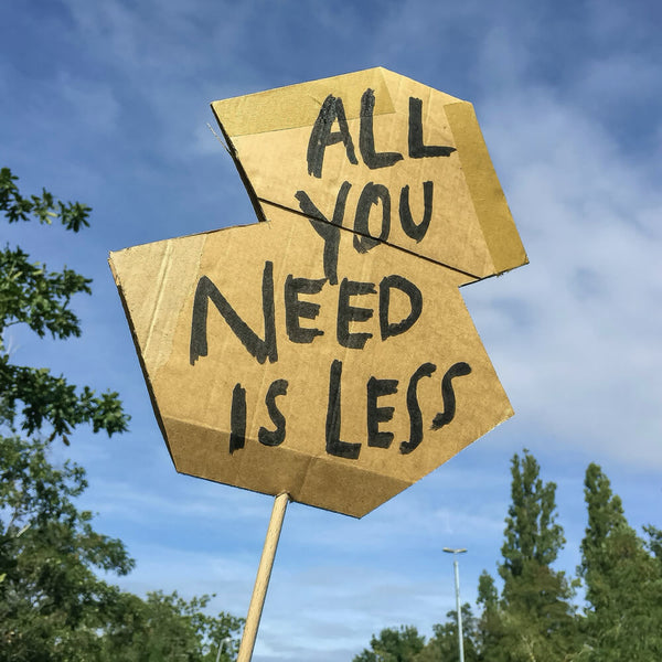 All You Need Is Less Sign   Road Sign