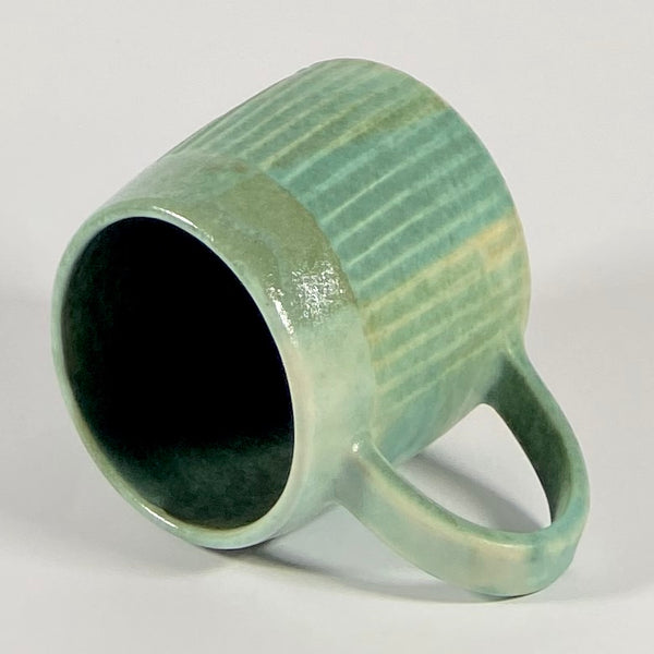 Wheel thrown carved stoneware mug