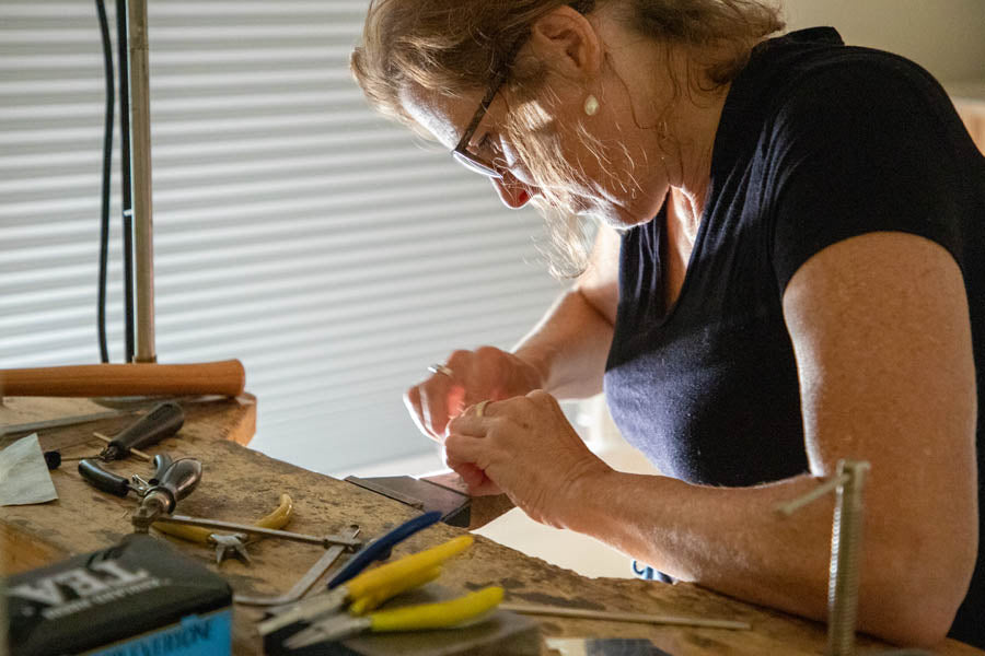 Vicki Westgate making jewellery at her bench