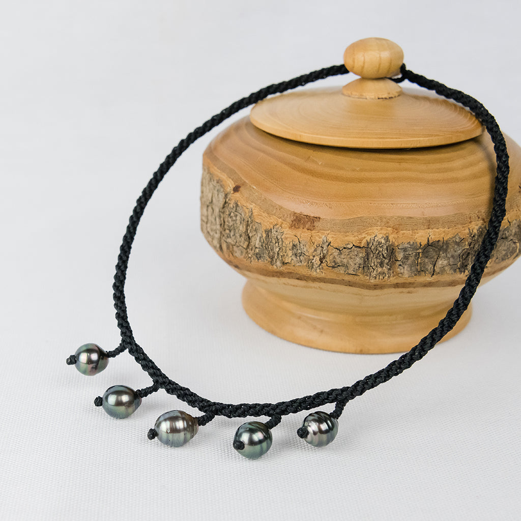 Black Choker with Five Baroque Tahitian Pearls around the Neck
