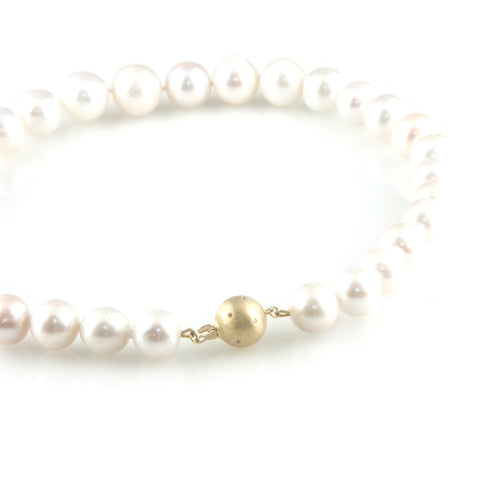'Pearl Wonder' - Pearl necklace with 18ct gold ball clasp and diamonds