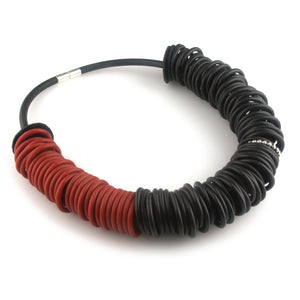 Black and red rubber necklace with one silver ring
