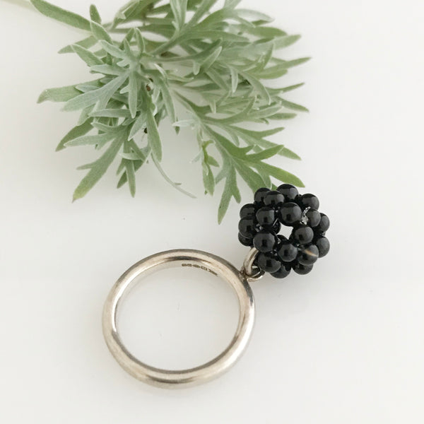 Silver ring with the cluster of onyx
