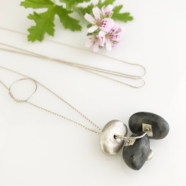 Silver necklace with silver and black porcelain stone shaped components
