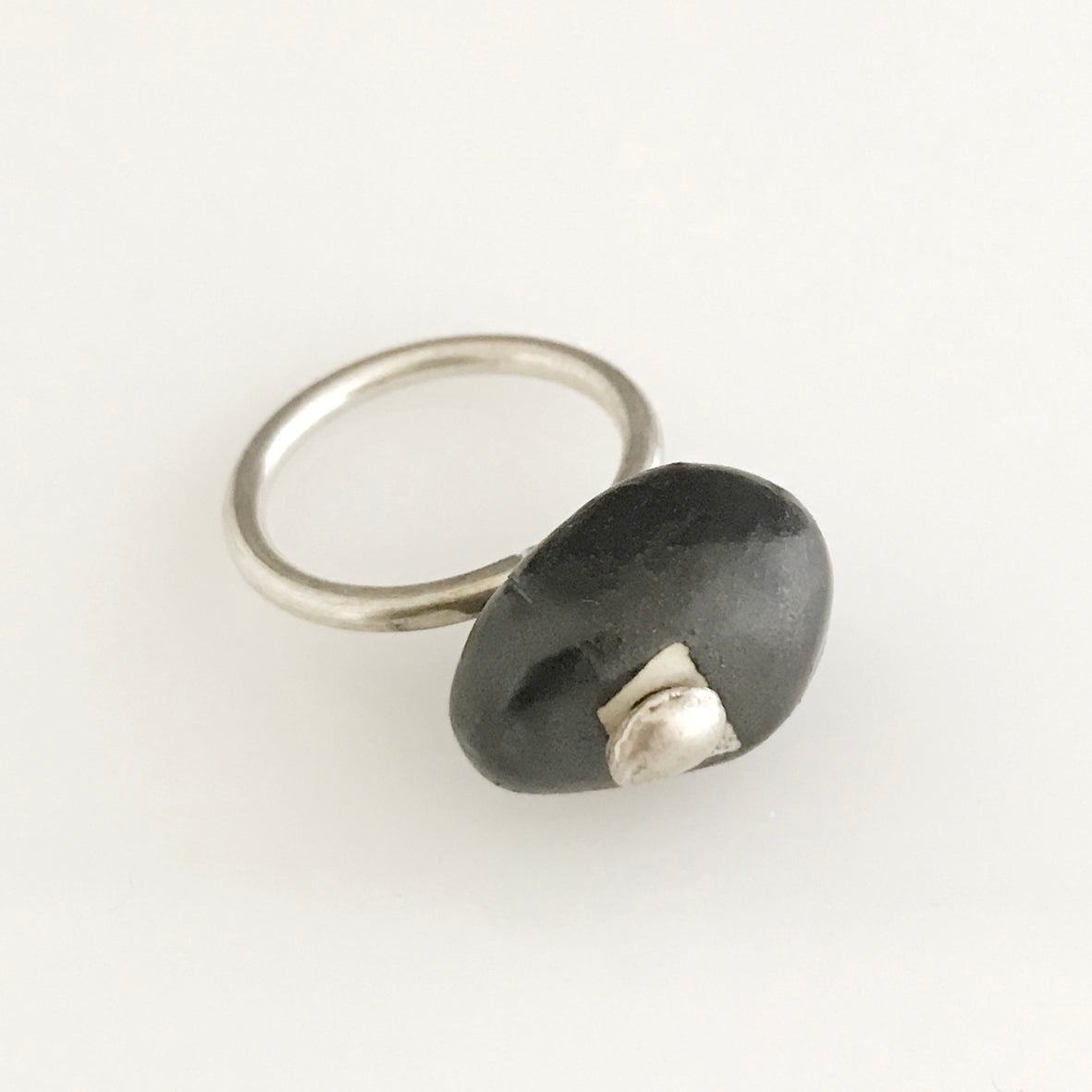 Black porcelain stone shaped silver ring