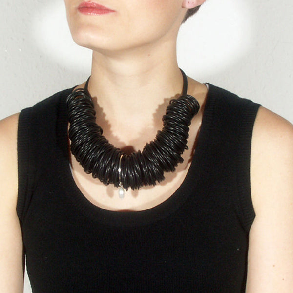 Black rubber necklace with silver ring and pearl