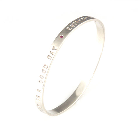 'Every day is a good day' - silver oval shape bangle with ruby
