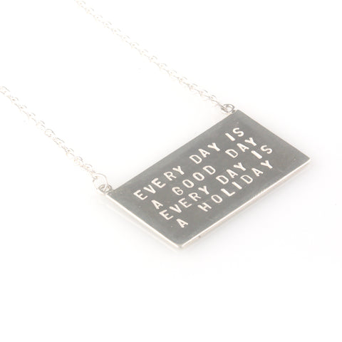'Every day is a good day' - silver pendant with wording 'every day is a good day'