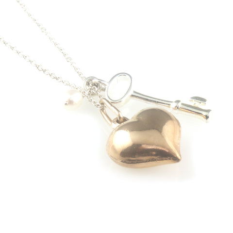 'Key to your heart' - small silver key and pearl with rose gold heart necklace