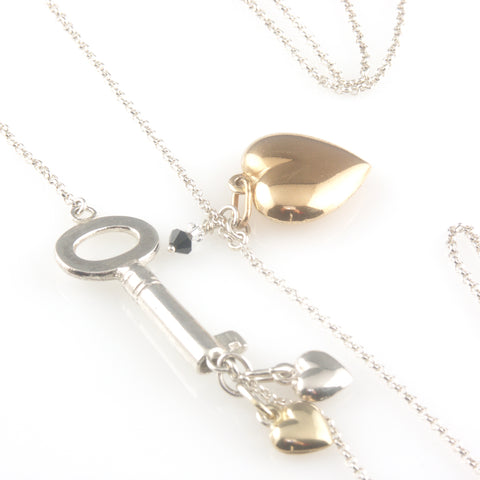 'Key to your heart' - long silver key and hearts necklace