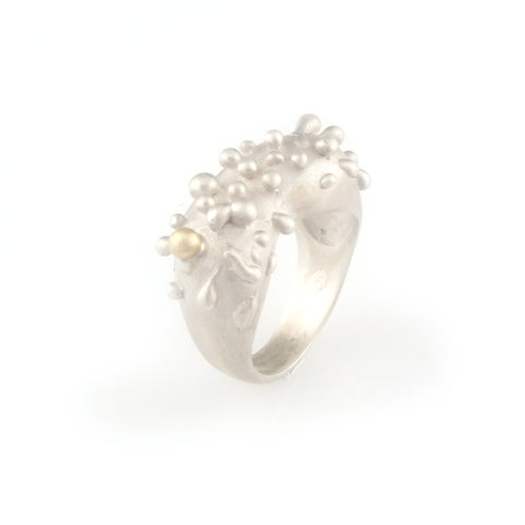 Silver ring with gold droplet