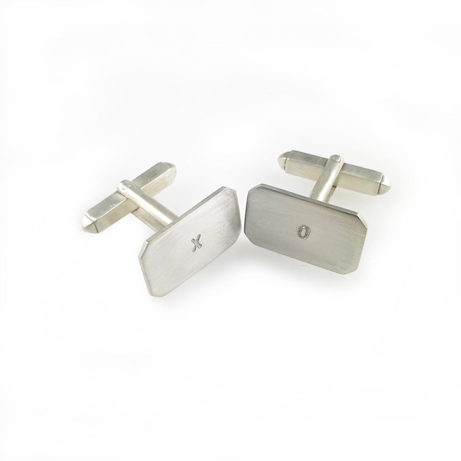 'X collection' - silver cufflinks with words 'X' and 'O'
