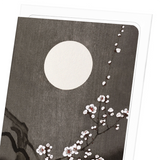 Flowering plum blossom at full moon