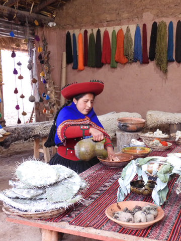 Inca woman dyes the wool