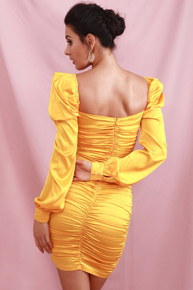 Bodycon dress in yellow satin with cutouts