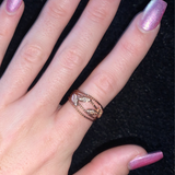 Woman wearing rose gold and crystal ring.
