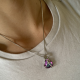 Woman wearing crystal heart necklace
