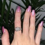 Woman wearing a crystal white gold ring.