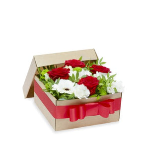 Arrangement in a box with roses and other flowers.