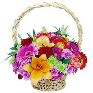 Spring basket with various flowers in bright colors that will impress the recipients!