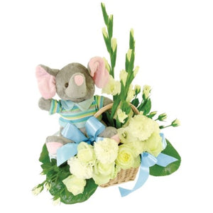 Composition with flowers and teddy bear in light blue and white for a newborn baby boy.