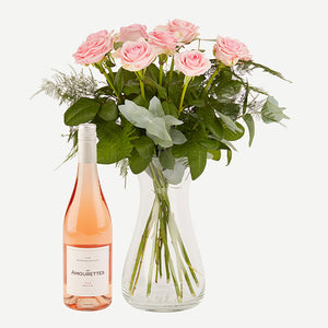 The pink roses are uniquely combined in an airy bouquet accompanied by a high quality French Rosé wine of well-known etiquette to create a wonderful gift for your loved ones.