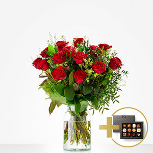 Erotic bouquet with red roses and a box of chocolates.