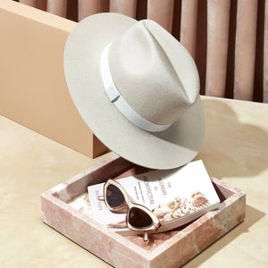 The Classic Fedora in Silver Sand. Beautiful photography and imagery. Unique neutral colors and size inclusive hat company. Custom hats online. Modern, structured, wide-brim hats. Unisex brand.