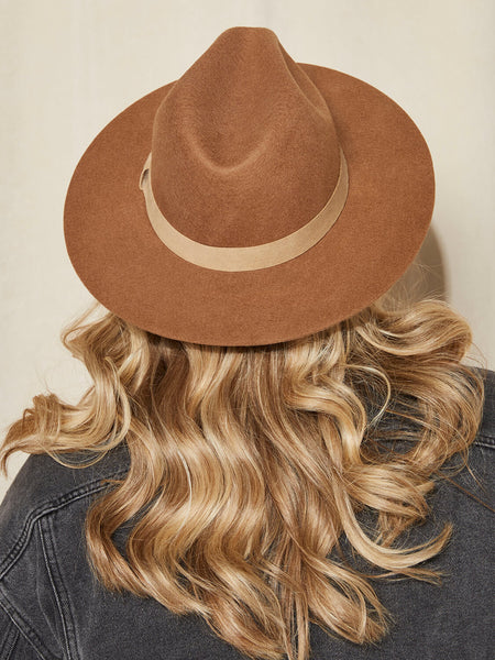 The Classic Fedora in Brown Sugar in unique neutral color. Beautiful photography and imagery. Unique neutral colors and size inclusive hat company. Custom hats online. Modern, structured, wide-brim hats. Unisex brand.