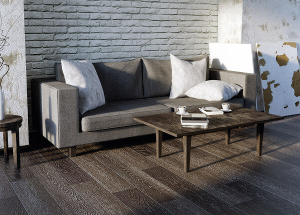 Living room with grey couch and table on laminate flooring