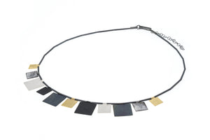 Square shape multi pendant necklace in 3 colour finish of Sterling Silver, black oxidised and yellow vermeil