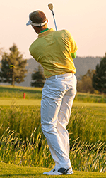 Golfer trying to swing with hip pain