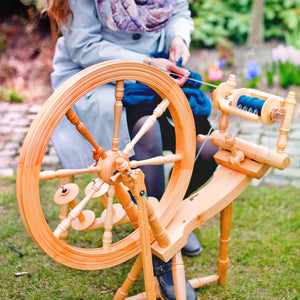 spinning wheels flyers bobbins and drop spindles