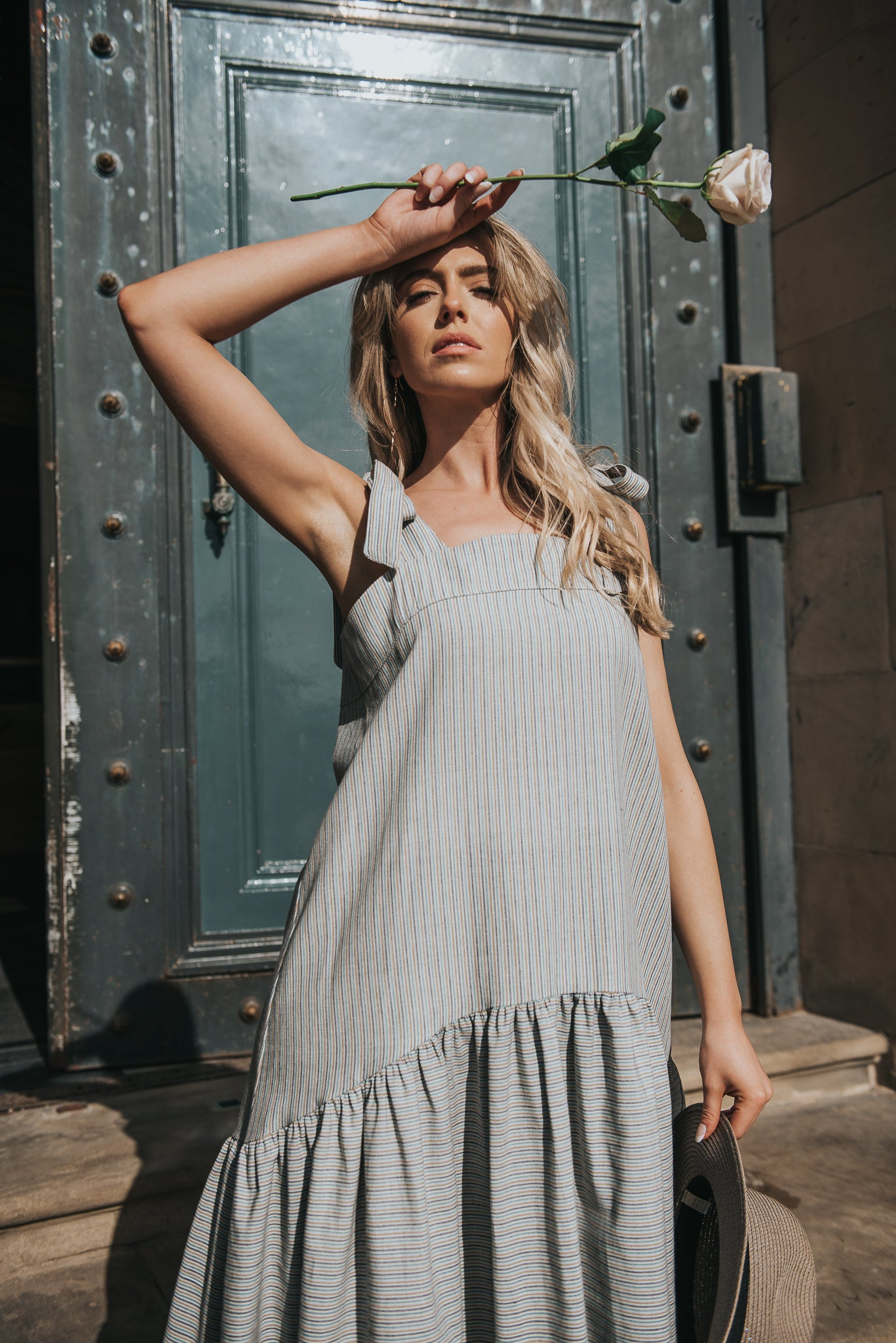 Adelia Dress in Meadow Stripe. Our hand loomed cotton, with tonal blue and green stripe. Features bow tie shoulders and comfortable smock drop waist silhouette.