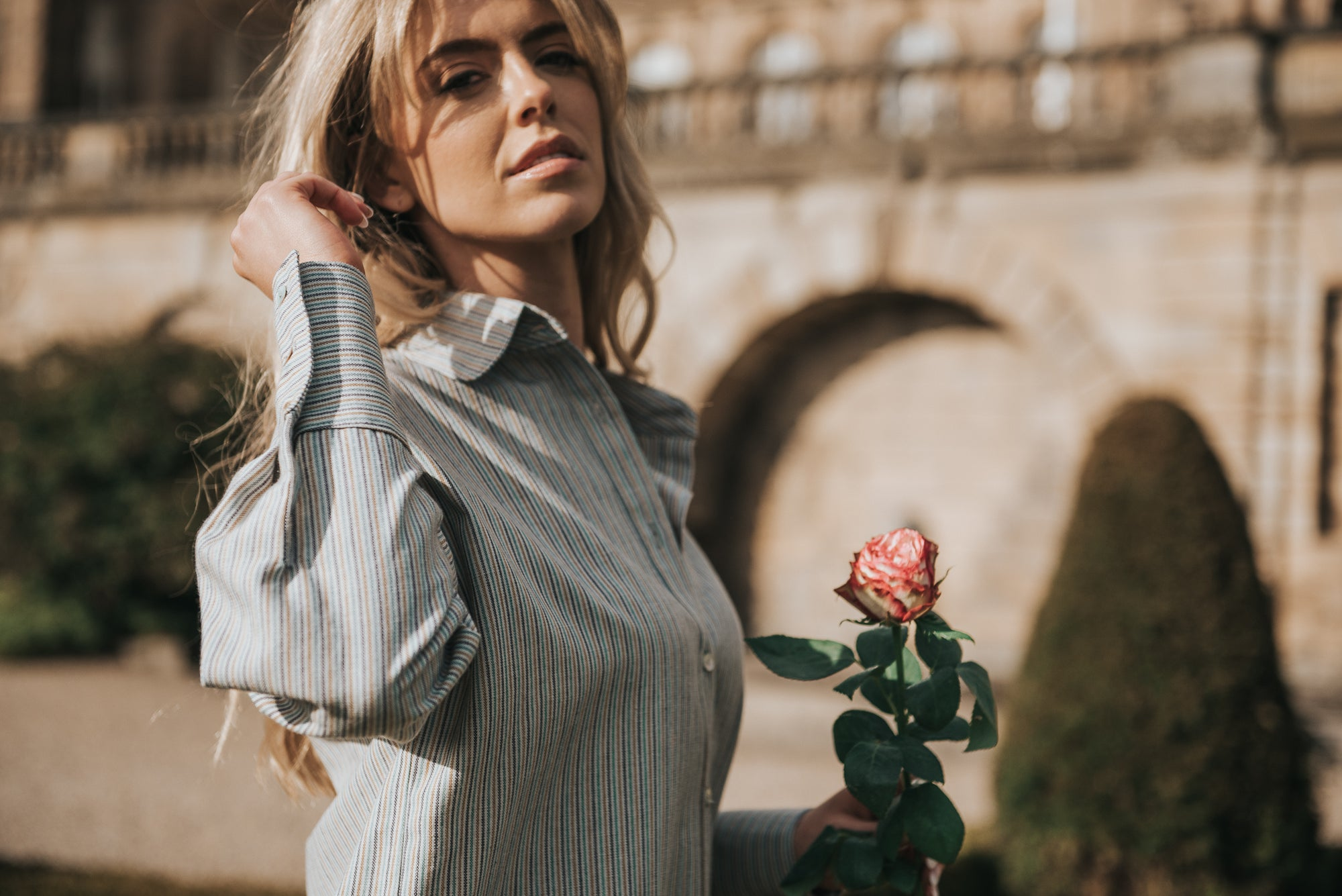 Garden romance, the perfect scene starring the Margeaux shirt in Meadow Stripe - here you can see the natural shell buttons glint in the golden hour sunlight