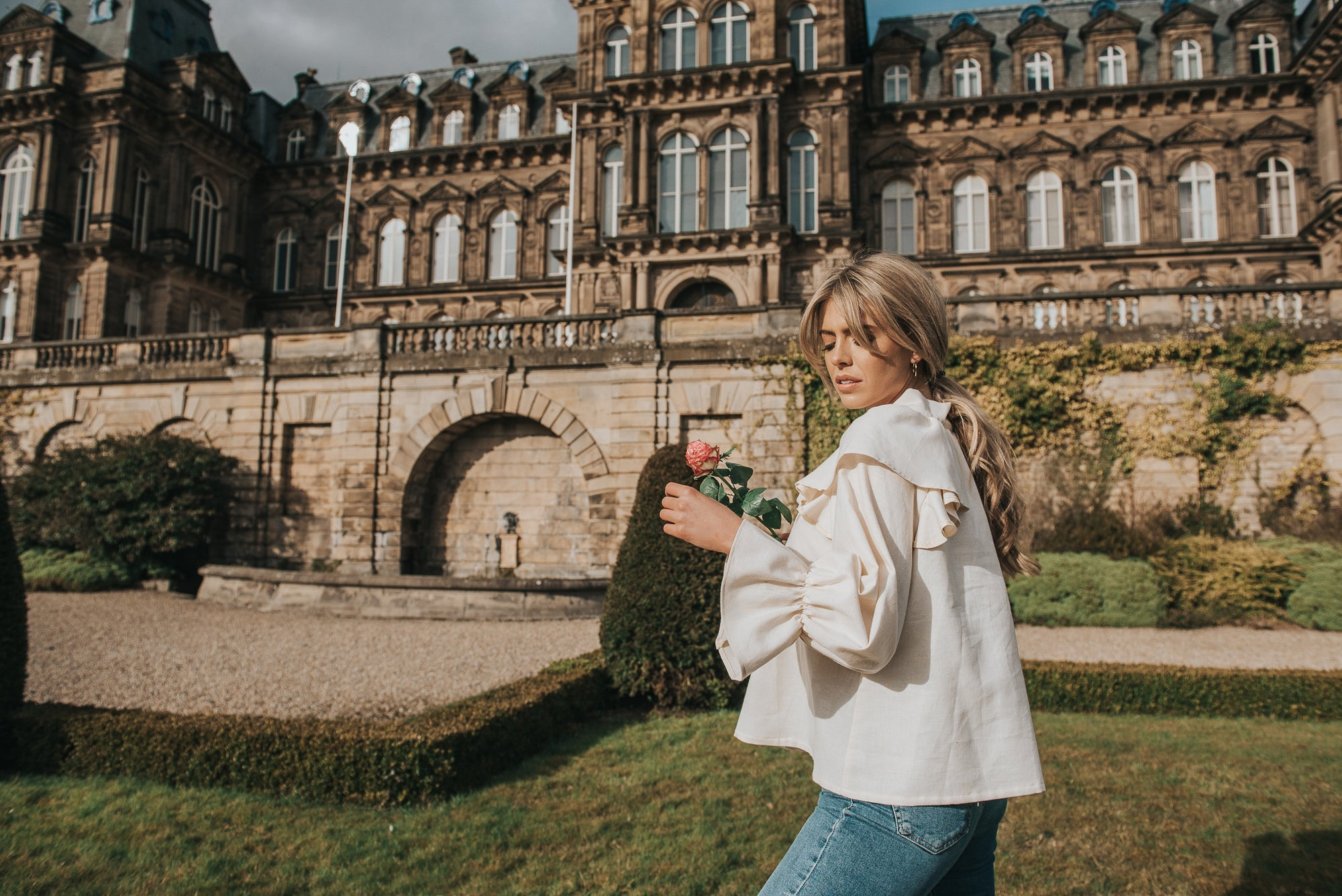 In the grounds of the Bowes Museum, Calla wears the beautifully feminine Marcella blouse. With delicate frills and a raglan sleeve, this east cut works perfectly with your fave pair of skinny jeans