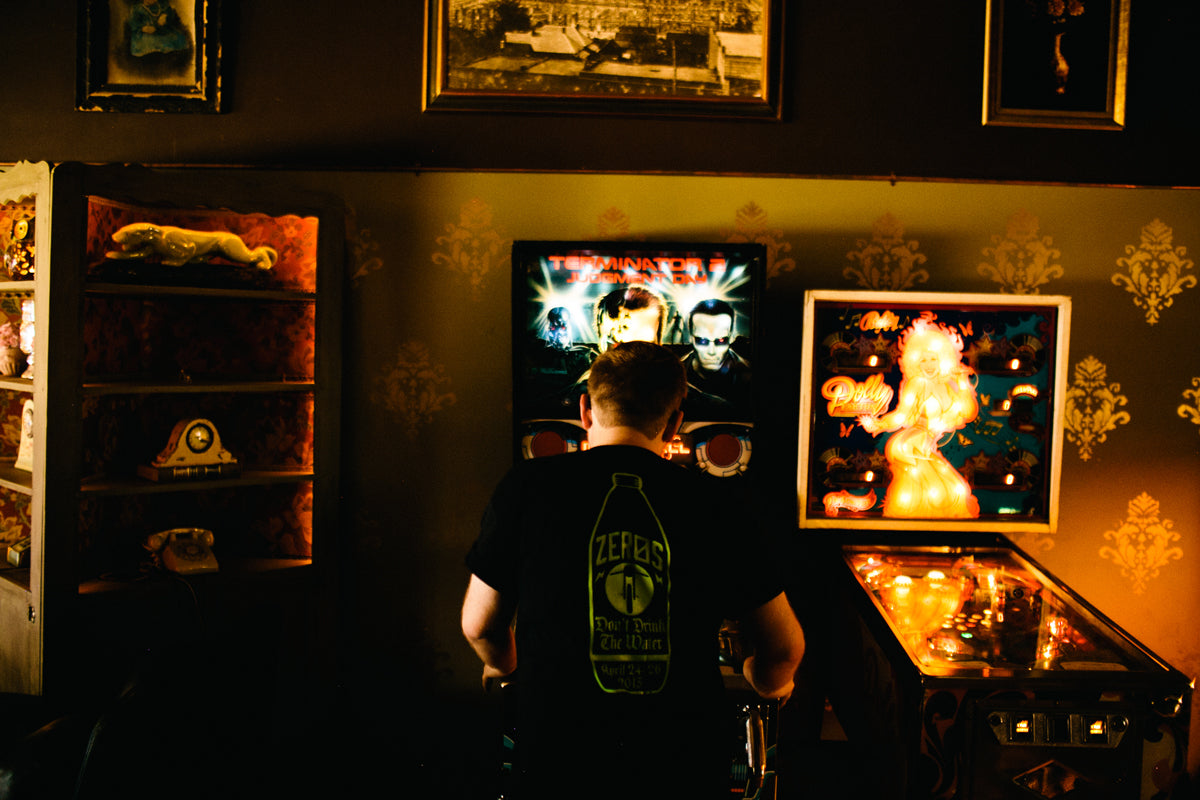 zac till - playing pinball at joystick in atlanta
