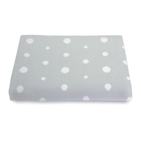 Cotton Bassinet Blanket in Dove Grey with white spots, lifestyle.