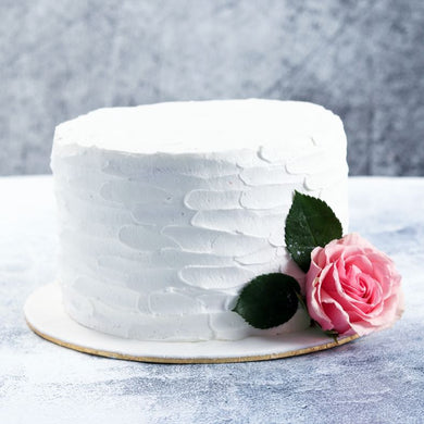 Elegant Cake - Cake Covered with White Frosting and Topped With Fresh  Rose Flower