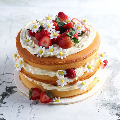 Daisy Cake - Vanilla Cake Layered With Frosting and Topped With Fresh Strawberries.