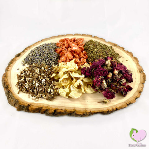 Holiday Mix for rabbits, guinea pigs, chinchillas, hamsters, degus and gerbils with self dried organic carrots and parsnips, Dandelion Root, Lavender and Rosebuds  Edit alt text.