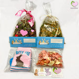 Gift Basket, Spring Gift Set with Somebunny Loves You Mix with self dried Dandelions, Hibiscus, Rosehips and Rosebuds for rabbits, guinea pigs, chinchillas, hamsters, degus and gerbils. Spring Mix with self dried Dandelions and banana chips, Calendulas, Chamomile, Chickweed and Yarrow Flowers. Self dried organic carrot and parsnip slices, bunny socks and fridge magnet.