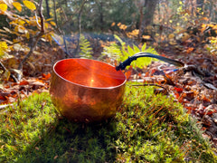 hand hammered copper mug with leather cord