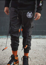 Load image into Gallery viewer, Front View Black Cargo Pants Black Buckles on Model