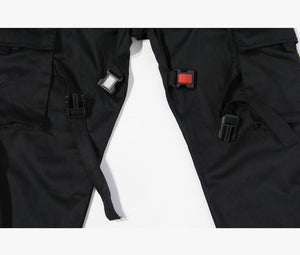 Close up reflective buckles on black cargo pants