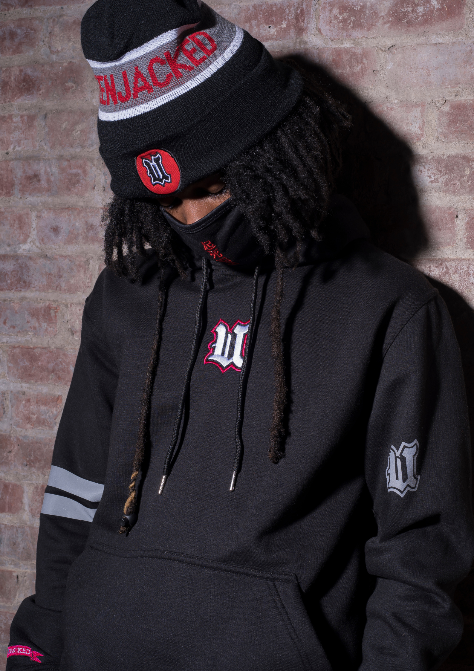 Model Wearing UBJ Beanie & Dreams Black Hoodie Front View