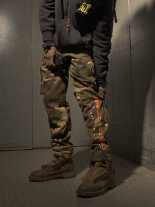 Lifestyle shot model wearing camo army pants