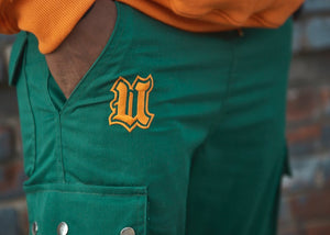 Close up UBJ logo embroidered green cargo pants