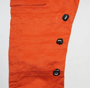 Orange cargo pants bungee cord detail
